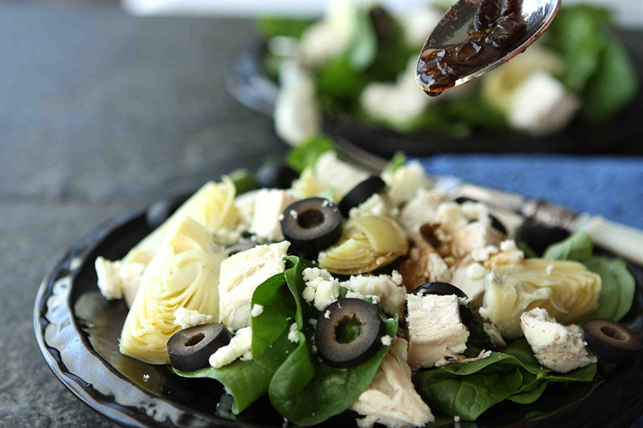 Tasty Kitchen Blog: Chicken Spinach Salad Warm Bacon-Artichoke Dressing. Guest post by Dara Michalski of Cookin' Canuck, recipe submitted by TK member Alessa and Tammi of Carolina Heartstrings.