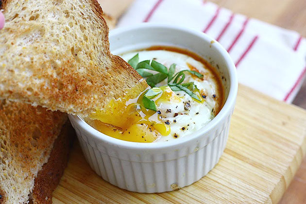 Tasty Kitchen Blog: Baked Eggs in Spicy Tomato Sauce. Guest post by Adrianna Adarme of A Cozy Kitchen, recipe submitted by TK member Erica of Apricosa.