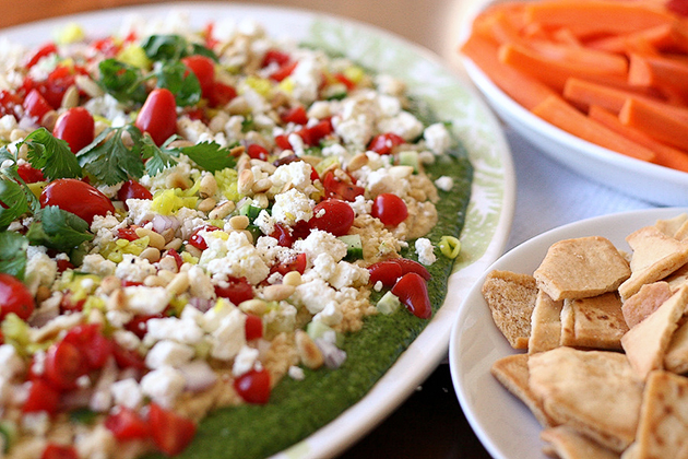 Tasty Kitchen Blog Cilantro Pecan-Pesto Layered Mediterranean Dip. Guest post by Natalie Perry of Perry's Plate, recipe submitted by TK member Beth (campgrandma) of Grandma B's Kitchen.