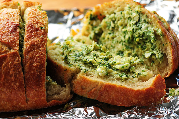 Tasty Kitchen Blog: Artichoke Feta Garlic Bread. Guest post by Amy Johnson of She Wears Many Hats, recipe submitted by TK member Traci of Lotta Madness.