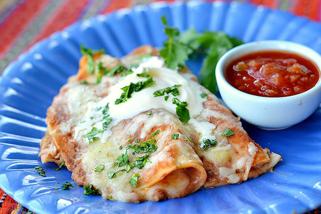 Tasty Kitchen Blog: Enfrijoladas. Guest post by Maggy Keet of Three Many Cooks, recipe submitted by TK member Caroline of Pink Basil.