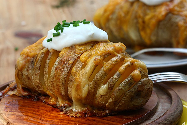 Tasty Kitchen Blog: Scalloped Hasselback Potatoes. Guest post and photo by Adrianna Adarme of A Cozy Kitchen, recipe submitted by TK member Shelbi Keith of Look Who's Cooking Now.