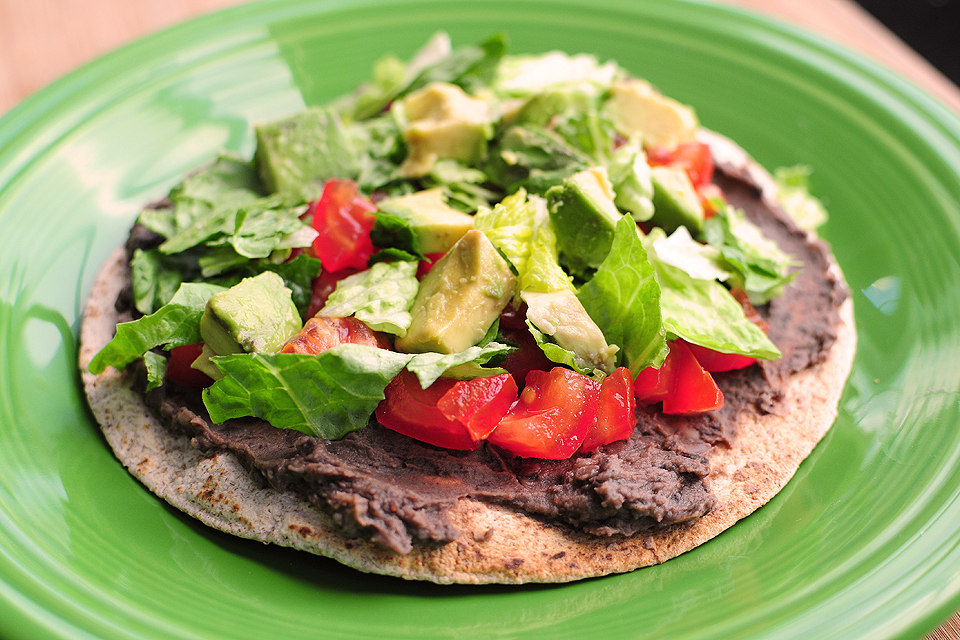 Tasty Kitchen Blog: Healthy Black Bean Tostadas with Cilantro Sauce. Guest post by Amy Johnson of She Wears Many Hats, recipe submitted by TK member Lindsay of Pinch of Yum.