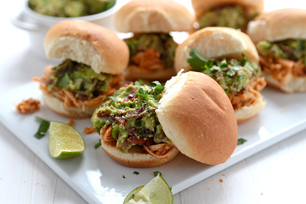 Tasty Kitchen Blog: Spicy Pulled Chicken Sliders with Bacon Queso Guacamole. Guest post by Megan Keno of Wanna Be a Country Cleaver, recipe submitted by TK member Serena of Domesticate Me.