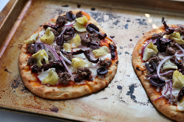 Tasty Kitchen Blog: Greek Lamb Naan Pizzas. Guest post by Megan Keno of Wanna Be a Country Cleaver, recipe submitted by TK member Marie of Little Kitchie.
